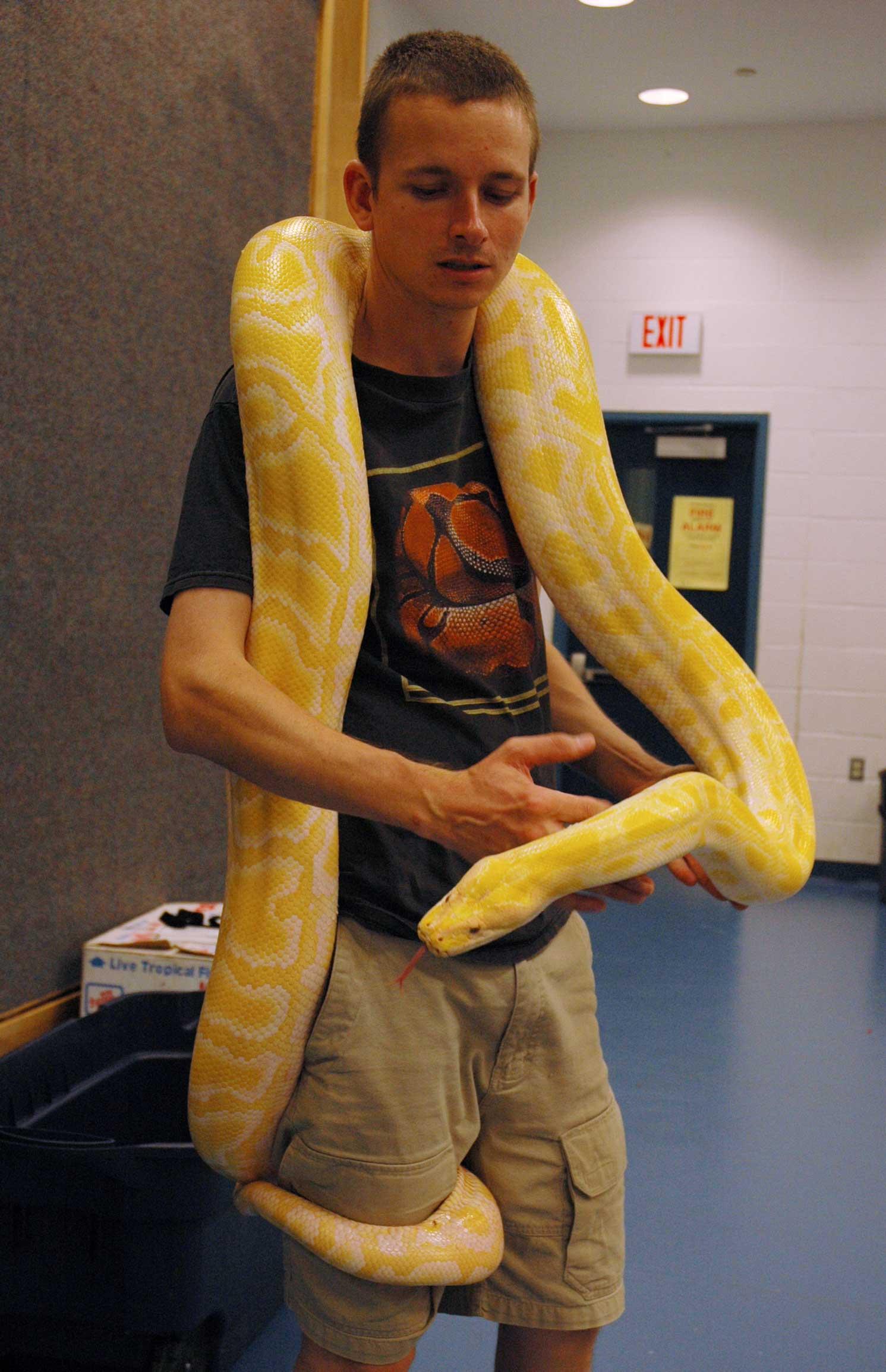 Arie with Albino Burmese Python