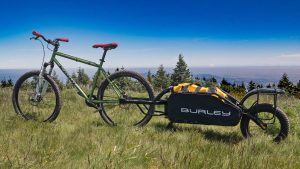 a mountain bike pulling a trailer