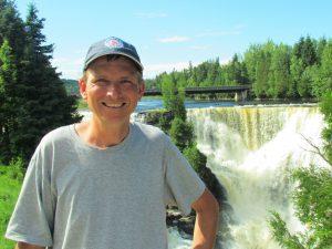 man beside Kakebeka Falls
